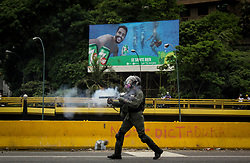 Bolivarian National Guard cash launches tear gas to protesters protesting against President Nicolas Maduro this May 3, 2017 on the Francisco Fajardo motorway.