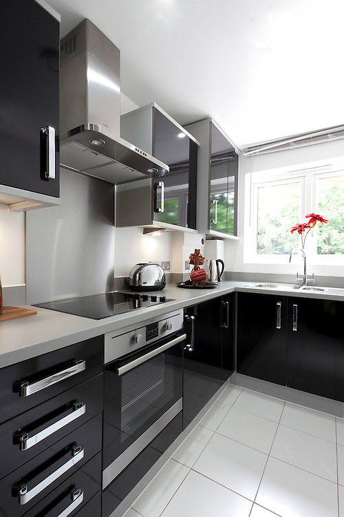 show house kitchen, black units, red flower