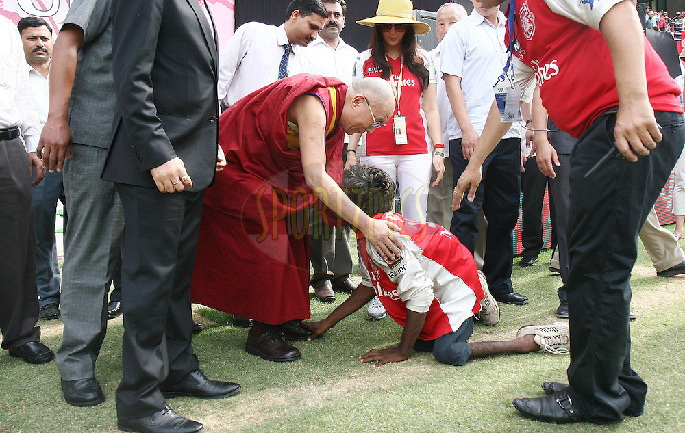 A handicapped man touches His Holliness Dalai Lama's feet before match 67 of the Indian Premier League ( IPL ) Season 4 between the Kings XI Punjab and the Deccan Chargers held at the The HPCA Stadium in Dharamsala, Himachal Pradesh, India on the 21st May 2011..Photo by Money Sharma/BCCI/SPORTZPICS