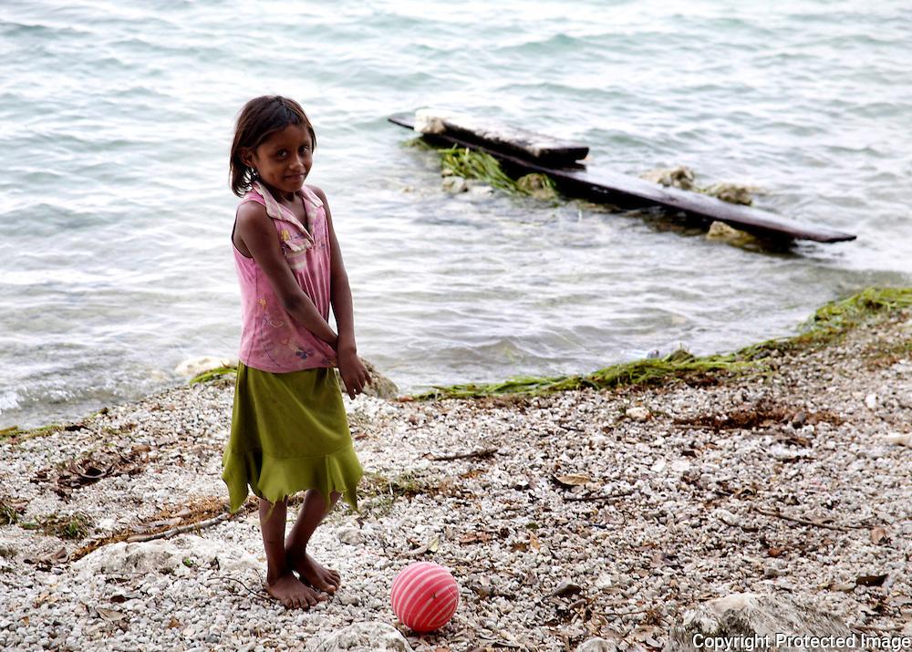 Mayan girl on lake shore in Guatemala