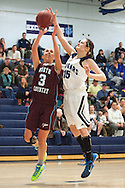 North Country's Michaela Columbia (3) leaps past MMUs Lexi Mousley (15) for a lay up during the girls basketball game between the North Country Falcons and the Mount Mansfield Cougars at MMU high school on Monday night February 15, 2016 in Jericho. (BRIAN JENKINS/for the FREE PRESS)