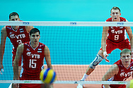 Russia's Alexey Spiridonov (right) looks to the ball while volleyball match between Brazil and Russia during the 2014 FIVB Volleyball World Championships at Spodek Hall in Katowice on September 14, 2014.<br /> <br /> Poland, Katowice, September 14, 2014<br /> <br /> For editorial use only. Any commercial or promotional use requires permission.<br /> <br /> Mandatory credit:<br /> Photo by © Adam Nurkiewicz / Mediasport