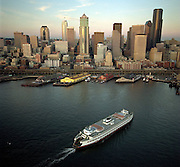 The Seattle skyline rises above Elliott Bay in Puget Sound as a Washington State Ferry comes into Colman Dock. (Benjamin Benschneider / The Seattle Times, 1994)