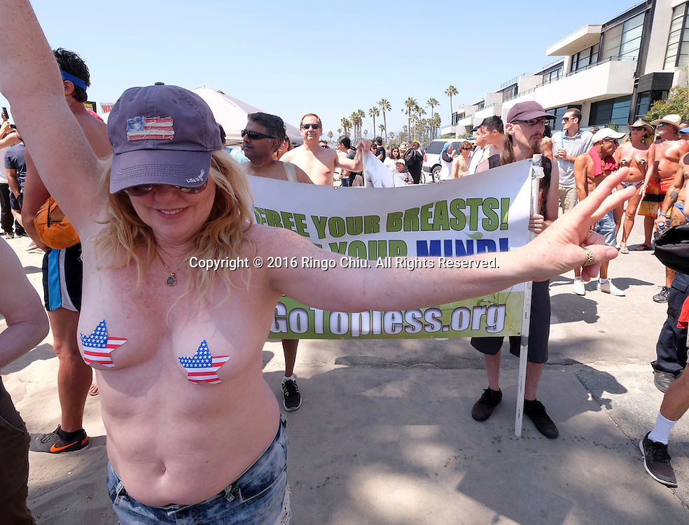 Topless women and men march to call for a constitutional amendment to give women the same right to go shirtless in public that men have during the National Go Topless Protest Day at Venice Beach on Sunday, August 28, 2016 in Los Angeles, California.(Photo by Ringo Chiu/PHOTOFORMULA.com)<br /> <br /> Usage Notes: This content is intended for editorial use only. For other uses, additional clearances may be required.