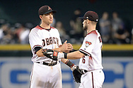 PHOENIX, AZ - JUNE 26:  Nick Ahmed #13 and Chris Owings #16 of the Arizona Diamondbacks high five after closing out the MLB game against the Philadelphia Phillies at Chase Field on June 26, 2017 in Phoenix, Arizona. The Arizona Diamondbacks won 6-1.  (Photo by Jennifer Stewart/Getty Images)