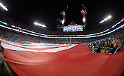 Fireworks go off above Bank of America Stadium as a giant American flag is held on the field before the Carolina Panthers NFL week 9 regular season football game against the New Orleans Saints on Thursday, Oct. 30, 2014 in Charlotte, N.C. The Saints won the game 28-10. ©Paul Anthony Spinelli