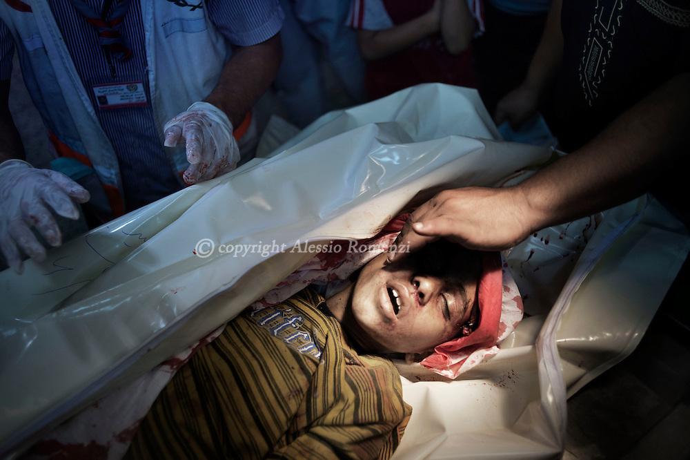 Gaza Strip, Gaza Strip: The body of Hibrahim Dawasa lies at Al Shifa hospital morgue after he has been killed by Israeli airstrike nearby his house in Jabaliya, northern Gaza Strip on August 8, 2012. ALESSIO ROMENZI