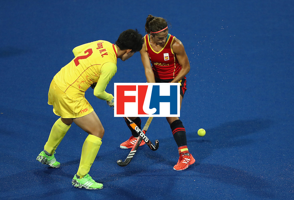 RIO DE JANEIRO, BRAZIL - AUGUST 08:  Mengyu Wang #2 of China battles Rocio Ybarra #3 of Spain for a loose ball during a Women's Pool A match on Day 3 of the Rio 2016 Olympic Games at the Olympic Hockey Centre on August 8, 2016 in Rio de Janeiro, Brazil.  (Photo by Sean M. Haffey/Getty Images)