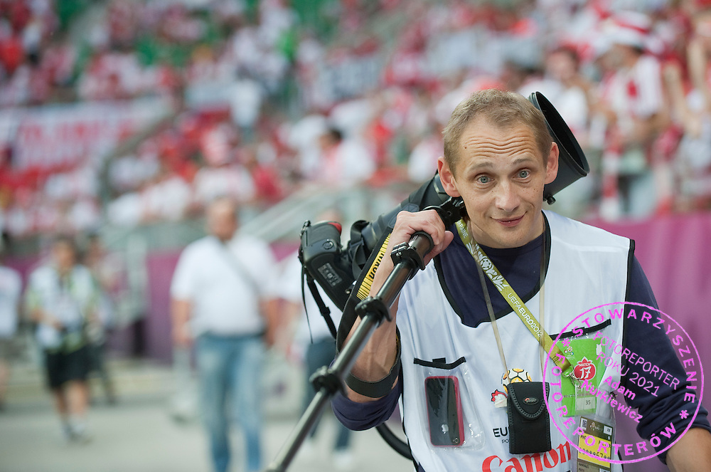 Photographer Piotr Hawalej during the UEFA EURO 2012 Group A football match between Poland and Czech Republic at Municipal Stadium in Wroclaw on June 16, 2012...Poland, Wroclaw, June 16, 2012..Picture also available in RAW (NEF) or TIFF format on special request...For editorial use only. Any commercial or promotional use requires permission...Photo by © Adam Nurkiewicz / Mediasport