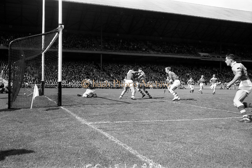 03/09/1967<br /> 09/03/1967<br /> 3 September 1967<br /> All-Ireland Minor Hurling Final: Cork v Wexford at Croke Park, Dublin.<br /> The Cork goalie, L. Gavin (left), fails to save a shot at the goal by Wexford forward, M. Quigley (right).