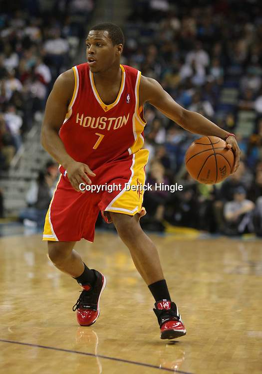 Jan 02, 2010; New Orleans, LA, USA; Houston Rockets guard Kyle Lowry (7) controls the ball against the New Orleans Hornets during a game at the New Orleans Arena. The Hornets defeated the Rockets 99-95.  Mandatory Credit: Derick E. Hingle-US PRESSWIRE