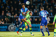 Wycombe Wanderers defender Sido Jombati(2) out jumps Norwich City forward Jordan Rhodes (11), on loan from Sheffield Wednesday, during the EFL Cup match between Wycombe Wanderers and Norwich City at Adams Park, High Wycombe, England on 25 September 2018.