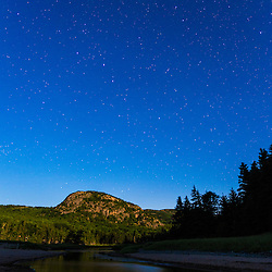 The Big Dipper over The Beehive bathed in moonlight. Maine's Acadia National Park.