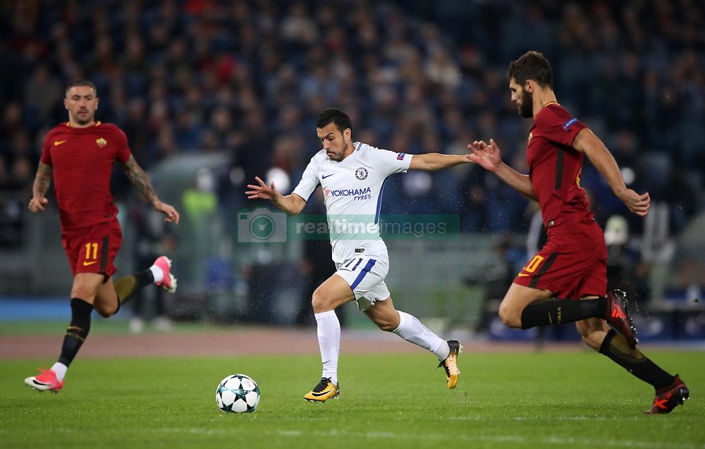 Chelsea's Pedro (centre) and Roma's Federico Fazio battle for the ball