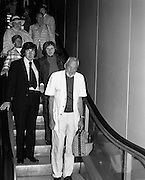 """John Huston Arrives In Dublin.   (J74)..1975..13.09.1975..09.13.1975..13th September 1975..The renowned film director,John Huston arrived in Dublin today. He had just flown in from Mexico to take part in """"Circasia 75"""" at Straffan House,Co Kildare.He is to take the part of ringmaster at the event...Image of John Huston and other passengers from his flight on their way to immigration at Dublin Airport."""