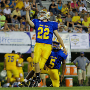 Blue kicker Adam Szczerba (22) of Saint Elizabeth High School kicks a extra point after Patton scored a touchdown in the fourth-quarter of the 58th Annual DFRC Blue-Gold All-Star Football game Saturday, June. 22, 2013, at Delaware Stadium in Newark DE.