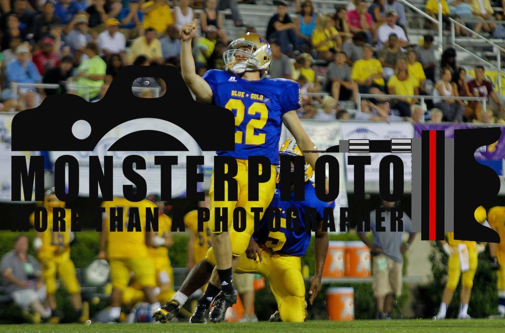 Blue kicker Adam Szczerba (22) of Saint Elizabeth High School kicks a extra point after Patton scored a touchdown in the fourth-quarter of the 58th Annual DFRC Blue-Gold All-Star Football game Saturday, June. 22, 2013, at Delaware Stadium in Newark DE.