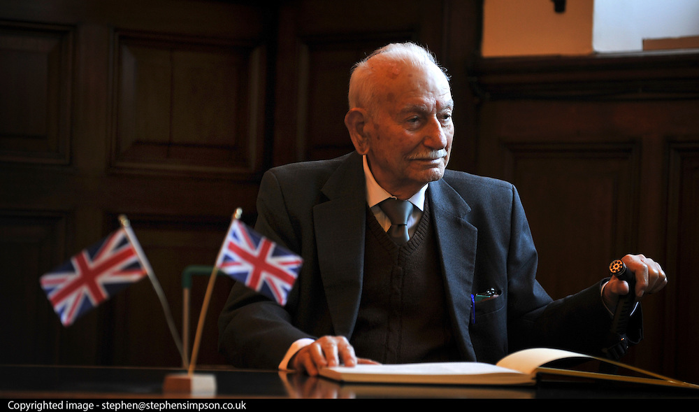 """© Licensed to London News Pictures. 02/02/2012, Kingston Upon Thames, UK. 104 year-old becomes Britain's oldest new citizen. 104 year-old TAUFEEK KHANJAR became a British Citizen at a cceremony held by Surrey County Council today (01 February 2012). Mr Khanjar is originally from Iraq and worked as a jewellery maker in Baghdad. He came to the UK six years ago to live with his daughter Nada Dabis, 59, in South Cheam, Surrey, where he enjoys walking, feeding the birds, playing cards and listening to music. He is a widower with four sons and two daughters. Durning the ceremony Mr Khanjar took an oath to the Queen, pledging that he will be a faithful citizen and obey the laws of the country. He explained the secret to a long and healthy life was to """"never get stressed and be relaxed"""".  Photo credit : Stephen Simpson/LNP"""