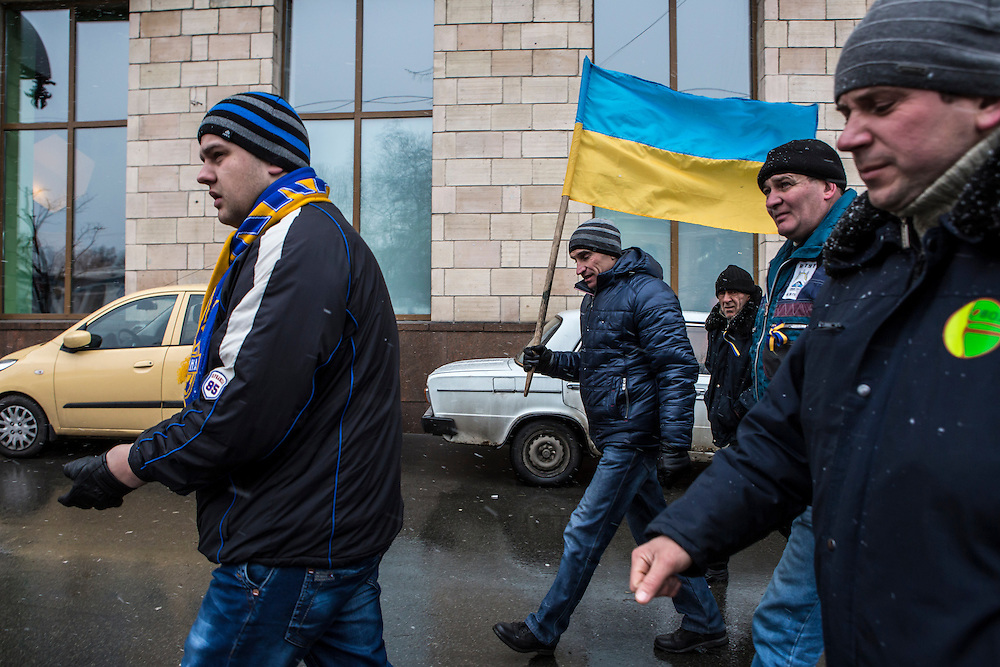 KIEV, UKRAINE - DECEMBER 6: Anti-government protesters walk toward the Cabinet of Ministers building on December 6, 2013 in Kiev, Ukraine. Thousands of people have been protesting against the government since a decision by Ukrainian president Viktor Yanukovych to suspend a trade and partnership agreement with the European Union in favor of incentives from Russia. (Photo by Brendan Hoffman/Getty Images) *** Local Caption ***