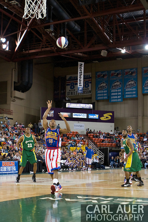 April 30th, 2010 - Anchorage, Alaska:  Buckets Blakes (15) of the Globetrotters tosses an ally-oop pass Friday night at the Sullivan Arena.