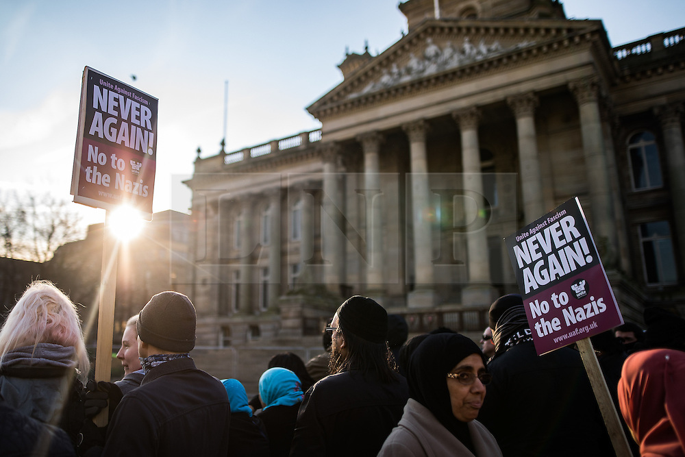 "© Licensed to London News Pictures . 26/11/2016 . Bolton , UK . Anti fascists outside Bolton Town Hall , pictured holding a counter demonstration . Approximately 100 people attend a demonstration against the construction of mosques in Bolton , under the banner "" No More Mosques "" , organised by a coalition of far-right organisations and approximately 150 anti fascists opposing the demonstration , in Victoria Square in Bolton Town Centre . Photo credit : Joel Goodman/LNP"