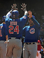 May 1 2011; Phoenix, AZ, USA; Chicago Cubs base runners Marlon Byrd (24) and Carlos Pena (22) score during the seventh inning against the Arizona Diamondbacks at Chase Field. The Diamondbacks defeated the Cubs 4-3. Mandatory Credit: Jennifer Stewart-US PRESSWIRE..