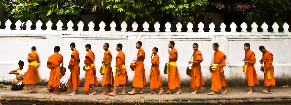 The monks accept offerings of food from devotees who believe that they &quot;make merit&quot; in return.<br /> (Photo by Matt Considine - Images of Asia Collection)