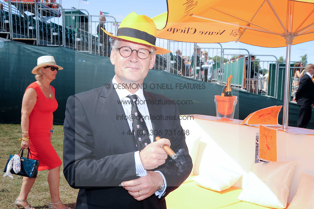 Stéphane Baschiera President of Veuve Clicquot at the Veuve Clicquot Gold Cup polo final held at Cowdray Park, Midhurst, West Sussex on 18th July 2010.<br /> StŽphane Baschiera President of Veuve Clicquot at the Veuve Clicquot Gold Cup polo final held at Cowdray Park, Midhurst, West Sussex on 18th July 2010.