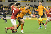 Nottingham Forest defender Eric Licha and Wolverhampton Wanderers midfielder Dave Edwards battle during the Sky Bet Championship match between Wolverhampton Wanderers and Nottingham Forest at Molineux, Wolverhampton, England on 11 December 2015. Photo by Alan Franklin.