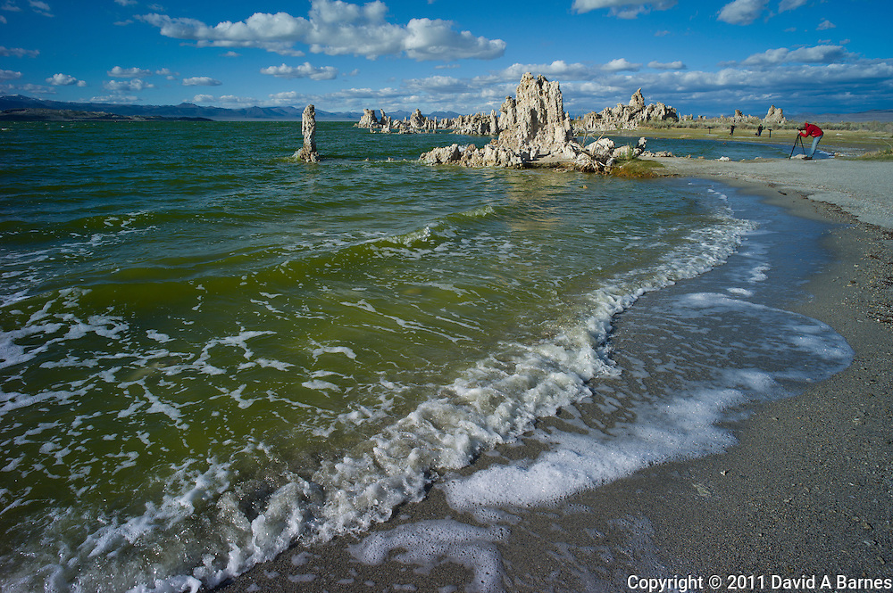 Photographer, Stacks of tufa on Mono Lake, California, USA