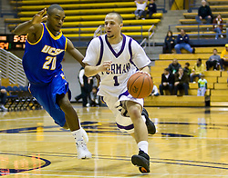 December 28, 2009; Berkeley, CA, USA;  Furman Paladins guard Justin Dehm (1) is guarded by UC Santa Barbara Gauchos forward James Nunnally (21) during the second half at the Haas Pavilion.  UC Santa Barbara defeated Furman 72-60.
