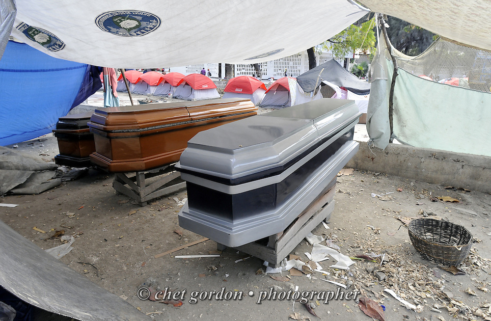 New coffins dry under a tarp in Port-au-Prince, Haiti on Saturday, January 30, 2010. A massive 7.0 earthquake struck the Caribbean island nation on January 12th., killing upwards of 200,000 people.
