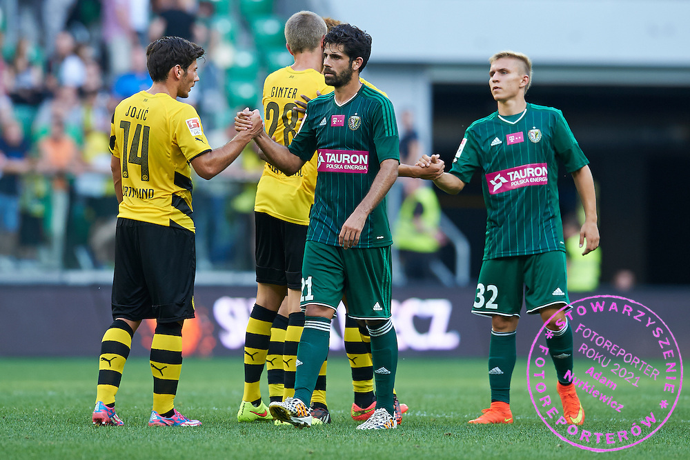 Juan Calahorro of Slask Wroclaw thanks for game to Milos Jojic of Dorussia Dortmund after international friendly soccer match between WKS Slask Wroclaw and BVB Borussia Dortmund on Municipal Stadium in Wroclaw, Poland.<br /> <br /> Poland, Wroclaw, August 6, 2014<br /> <br /> Picture also available in RAW (NEF) or TIFF format on special request.<br /> <br /> For editorial use only. Any commercial or promotional use requires permission.<br /> <br /> Mandatory credit:<br /> Photo by &copy; Adam Nurkiewicz / Mediasport