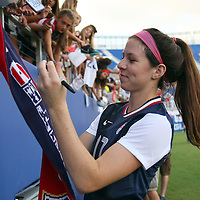 U.S. midfielder Erika Tymrak (17) signs autographs after an international friendly soccer match between the United States Women's National soccer team and the Russia National soccer team at FAU Stadium on Saturday, February 8, in Boca Raton, Florida. (AP Photo/Alex Menendez)