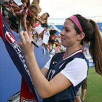 U.S. midfielder Erika Tymrak (17) signs autographs after an international friendly soccer match between the United States Women's National soccer team and the Russia National soccer team at FAU Stadium on Saturday, February 8, in Boca Raton, Florida. (AP Photo/Alex Menendez)