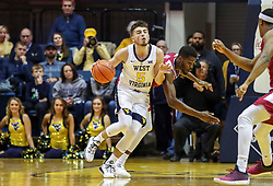 Nov 28, 2018; Morgantown, WV, USA; West Virginia Mountaineers guard Jordan McCabe (5) dribbles the ball up the floor during the second half against the Rider Broncs at WVU Coliseum. Mandatory Credit: Ben Queen-USA TODAY Sports