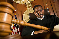 Middle-aged judge, gavel in front of him