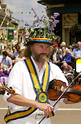Morris Men perform traditional music and dance in Middle England at Uppingham Market Square, Rutland, UK