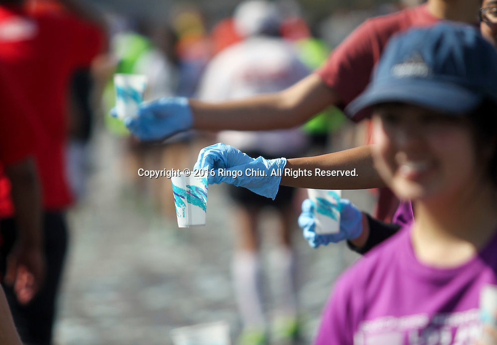 Runners pass through a water station along Santa Monica Boulevard during the 31st Los Angeles Marathon in Los Angeles, Sunday, Feb. 14, 2016. The 26.2-mile marathon started at Dodger Stadium and finished at Santa Monica.  (Photo by Ringo Chiu/PHOTOFORMULA.com)<br /> <br /> Usage Notes: This content is intended for editorial use only. For other uses, additional clearances may be required.