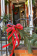 Christmas bows and roping decorate a historic home in Savannah, GA.