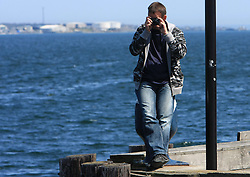 Photographer Ales Fevzer taking shots of whale watching boat with SLovenian team onboard, during IIHF WC 2008 in Halifax,  on May 07, 2008, sea at Halifax, Nova Scotia, Canada. (Photo by Vid Ponikvar / Sportal Images)