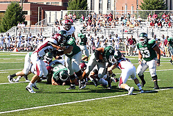 08 September 2012:  Sean Conley muscles his way through the middle of the line during an NCAA division 3 football game between the Alma Scots and the Illinois Wesleyan Titans which the Titans won 53 - 7 in Tucci Stadium on Wilder Field, Bloomington IL