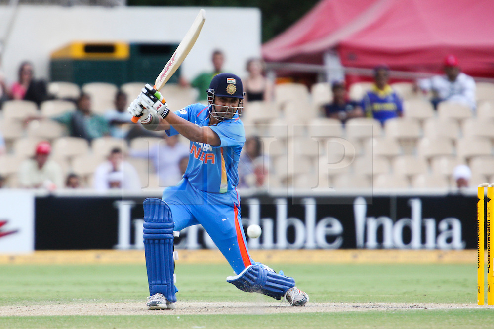 © Licensed to London News Pictures. 14/02/2012. Adelaide Oval, Australia. Gautam Gambhir plays a drive shot during the One Day International cricket match between India Vs Sri Lanka. Photo credit : Asanka Brendon Ratnayake/LNP