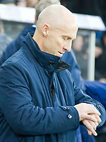 Football - 2016 / 2017 Premier League - Swansea City vs. Stoke City<br /> <br /> Swansea City manager Bob Bradley looks at his watch —, at The Liberty Stadium.<br /> <br /> COLORSPORT/WINSTON BYNORTH
