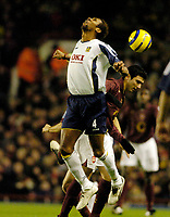 Photo: Leigh Quinnell.<br /> Arsenal v Portsmouth. The Barclays Premiership.<br /> 28/12/2005.Arsenals Jose Antonio Reyes rises with Portsmouths John Viafara.