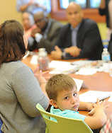 US Senator Cory Booker (D-NJ) speaks with Lisa Askew (left) as her son Stephen Askew turns to the camera at South Jersey Family Medical Center Saturday, July 29, 2017 in Burlington, New Jersey. (Photo by William Thomas Cain)