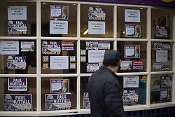 © Licensed to London News Pictures . 03/02/2017. Stoke-on-Trent, UK . People pass the UKIP shop in Hanley town centre in the constituency of Stoke-on-Trent Central . The by-election in the constituency is due to take place on 23rd February . Photo credit: Joel Goodman/LNP