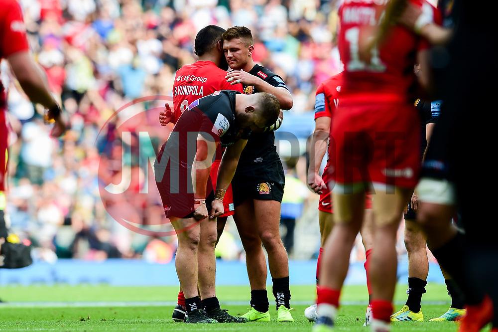 Henry Slade of Exeter Chiefs hugs Billy Vunipola of Saracens - Mandatory by-line: Ryan Hiscott/JMP - 01/06/2019 - RUGBY - Twickenham Stadium - London, England - Exeter Chiefs v Saracens - Gallagher Premiership Rugby Final