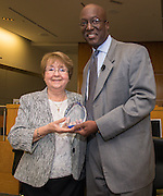 Interim Superintendent Ken Huewitt presents Herlinda Garcia, left, with a leadership award during a Professional Leadership Series meeting, April 6, 2016.