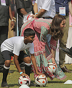 April 10, 2016 - Mumbai, INDIA - <br /> <br /> The Duchess of Cambridge, the former Kate Middleton, plays with Indian children during a charity event at the Oval Maidan in Mumbai, India, Sunday, April 10, 2016. The royal couple began their weeklong visit to India and Bhutan, by laying a wreath at a memorial Sunday at Mumbai iconic Taj Mahal Palace hotel, where 31 victims of the 2008 Mumbai terrorist attacks were killed. <br /> ©Exclusivepix Media